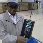 Dr. Lynch Testing Air Quality in Gym